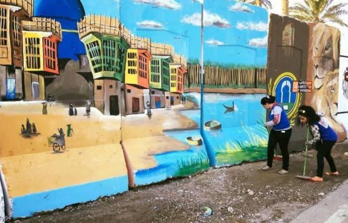 E i troppi muri della capitale irachena via via acquistano colore.